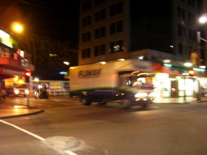 Crossing Courtenay Place, the little forklift chugging behind © Copyright Museum of New Zealand Te Papa Tongarewa, 2008