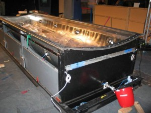 The squid tank with the display ends removed and most of the liquid drained off.