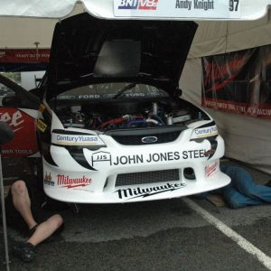 Legs under car