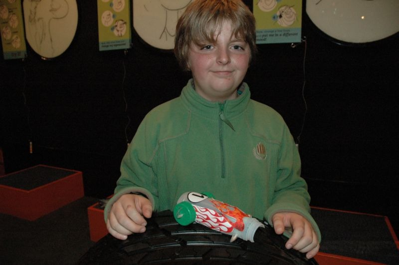 Callum with his flaming race car. © Te Papa, 2009.