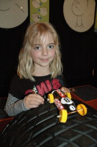 Grace and her distinctive yellow-wheeled racer. © Te Papa, 2009.