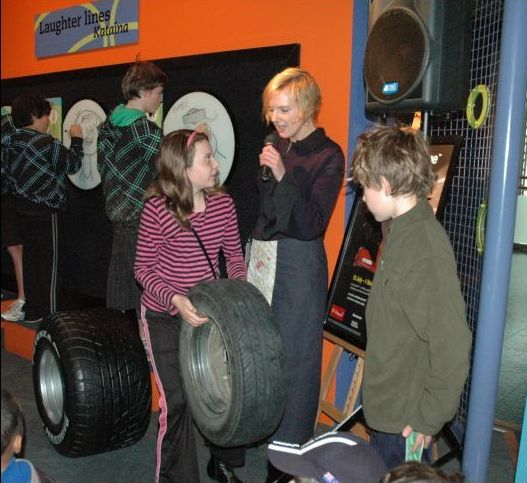 Tiana and Jaiden check the weight of a street car tyre. © Te Papa, 2009.