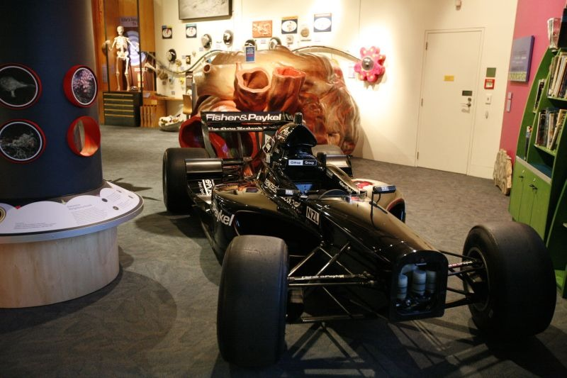 NZL A1GP car wheeling past the blue whale's heart model in NatureSpace. Copyright Te Papa 2009.