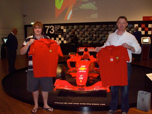 Dan and Sean with their signed shirts in front of the Ferrari F2004. Copyright Te Papa.