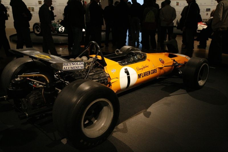 The papaya-orange McLaren M7A. Copyright Te Papa 2009.