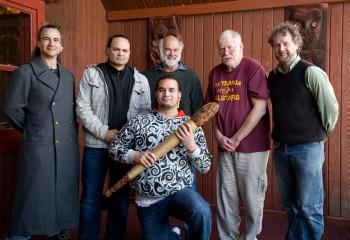 Hau Manu members Warren Warbrick, James Website, Brian Flintoff, Richard Nunns, Alistair Fraser and Horomona Horo in front of Te Heke-Mai-Raro