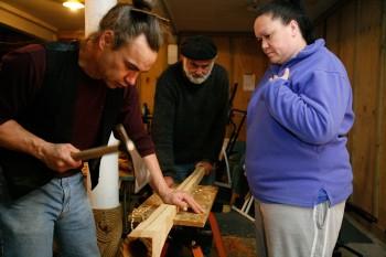 Warren Warbrick, Brian Flintoff and Jo Pleydell working on a pukaea. Copyright Te Papa