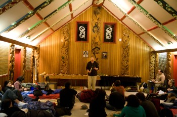 Richard Nunns introducing the group to taonga puoro. Copyright Te Papa