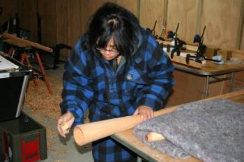 Awhina Tamarapa working on her pukaea. Copyright Florence Liger