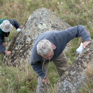 Peter and Pat look for mosses on rocks outside the forest. Photo by Jean-Claude Stahl. © Te Papa.