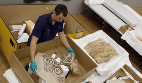 Preparing to install some of the masks from Papua New Guinea.