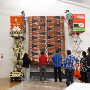 The 5 metre long tapa from Mangaia, in the Cook Islands is hung on the wall.