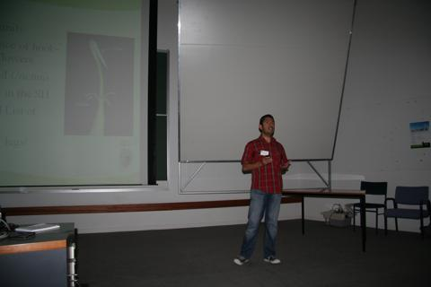 Carlos Lehnebach giving his talk on Uncinia at the ASBS conference, Dec 2010. Photo by Heidi Meudt, © Te Papa.