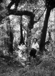 B.021003 Woman tramper in teh bush: 'Ascent of Kapakapanui' 1-2 March 1930. Photographer Leslie Adkin. Te Papa
