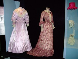 1909 Wedding dress (left) replaces 1900s day dress (right) in Eyelights gallery. Photogrpah by Kirstie Ross
