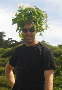 Antony being attacked by a head band of Calystegia silvatica (great bindweed). Leon Perrie, © Te Papa.