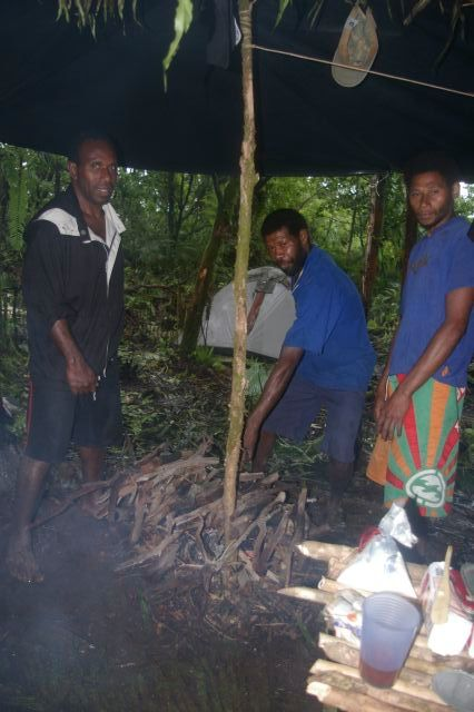 Anaclet, Manaman and Ala drying firewood