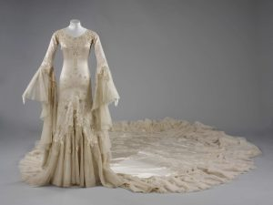 Embroidered silk satin wedding dress by Norman Hartnell, London, 1933. Commissioned by Margaret Whigham for her marriage to Charles Sweeny on 21 February 1933. Given and worn by Margaret, Duchess of Argyll. ©Victoria and Albert Museum / V&A Images