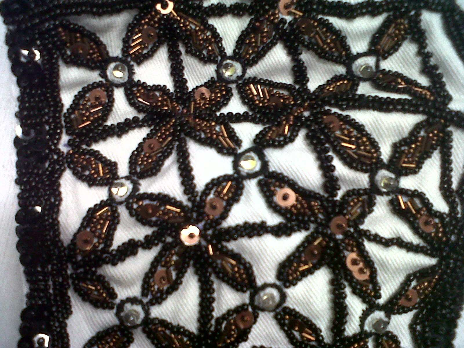Detail of the beaded headdress by Lindah Lepou. Collection of Te Papa.