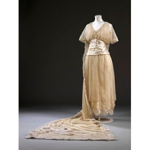 Beaded lace wedding dress and train designed by Aida Woolf, London, 1914. Worn by Phyllis Blaiberg for her marriage to Bertie Mayer Stone at the Bayswater Synagogue, London on 9 September 1914. Gift of Mrs B. Rackow