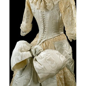 Ball gown consisting of a bodice and skirt in moiré silk with machine lace, probably made in Great Britain, ca. 1885. Collection of the Victoria and Albert Museum. Given by the Hon.S.F. Tyser