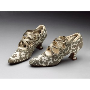 Silk brocade shoes purchased from Peter Robinson, London, 1914. Worn by Phyllis Blaiberg for her marriage to Bertie Mayer Stone at the Bayswater Synagogue, London on 9 September 1914. Given by Mrs B. Rackow