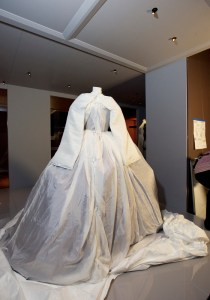 A dress in its specially made protective silk 'travelling garment'.