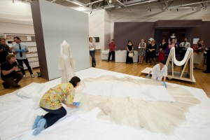 Anne and Keira remove the 'duvet'. Photo: Kate Whitley, Te Papa