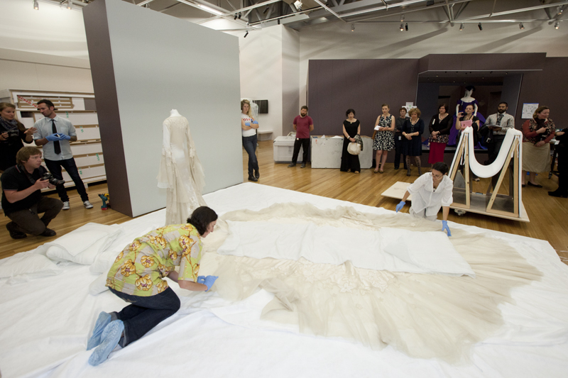 Anne and Keira remove the 'duvet'. Photo: Kate Whitley, Te Papa