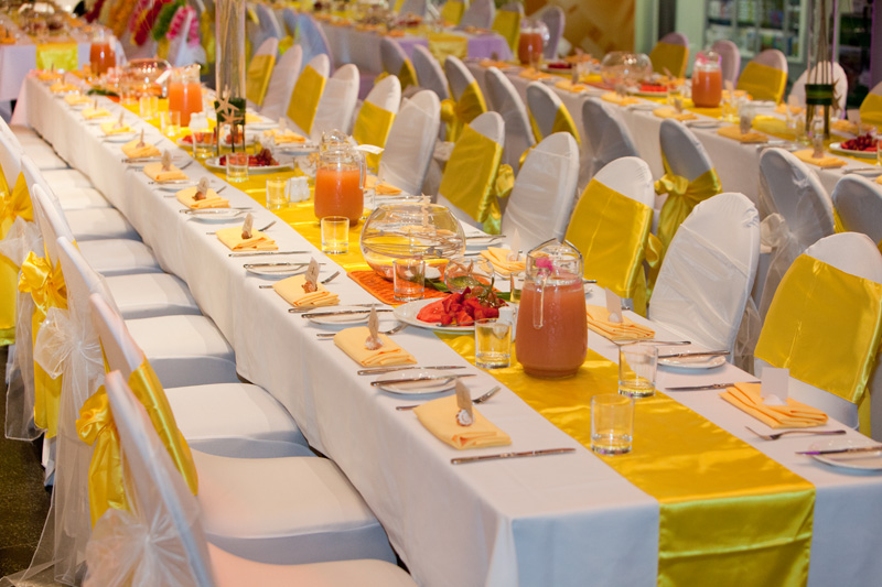 Tables set for a wedding breakfast Pacific style. Photo: Michael Hall, Te Papa.