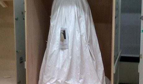 A wedding dress from the V&A patiently waiting to be unveiled for display.