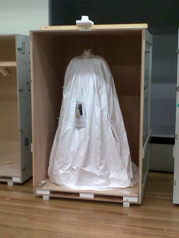 A wedding dress from the V&A patiently waiting to be unveiled for display. Photo: Claire Regnault, Te Papa