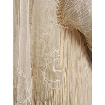 Pleated silk and silk net with rubber decoration by Ian and Marcel. ©Victoria and Albert Museum / V&A Images