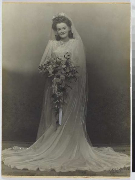 Carol Thomas (nee Gifford) wearing her parachute silk and lace wedding dress, 1946. Photographer unknown. Gift of the Thomas Family, 2011, Te Papa.
