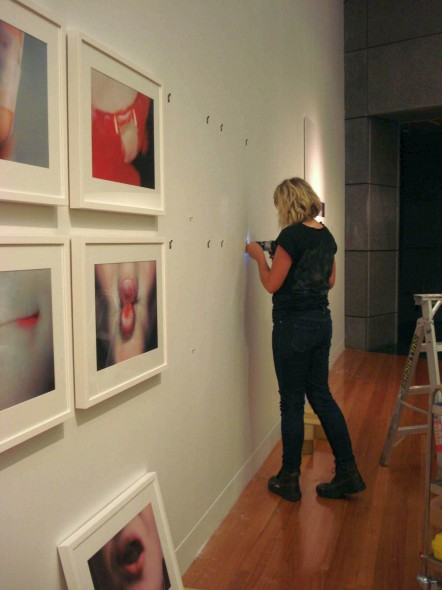 Te Papa installer Sam installs a suite of works by Wellington photographer Anne Noble, Ruby's room, 1998–2007. Photo: Sarah Farrar, Te Papa