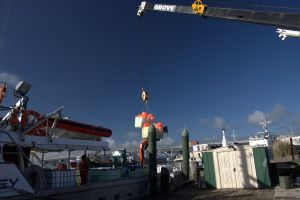 The MV Tranquil Image is being loaded with scientific gear in Tauranga
