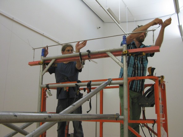 Te Papa installers Brad and Callum install the suspension rig for Jim Allen's works. Photo: Te Papa