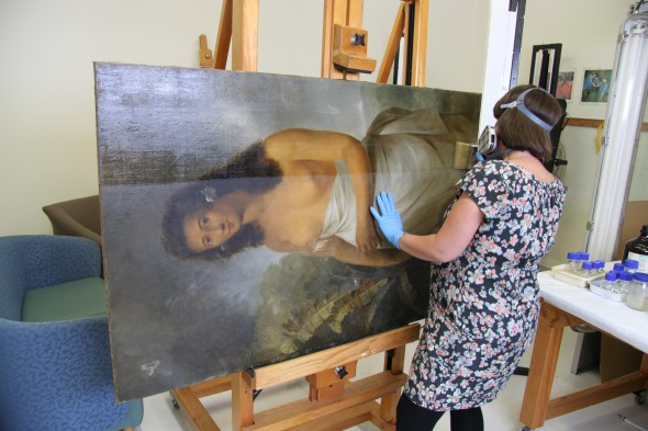The early stages of the brush varnishing of the painting.  Photograph taken by Katherine Campbell, © Te Papa.