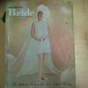 New Zealand Bride: The Authentic Guide to the New Zealand Wedding was published annually as a 'reference book' for brides and their families, by Lucas-Althman. The cover features a gown called 'Champtalisa' made from Italian crocheted lace. It is by Vinka Lucas.