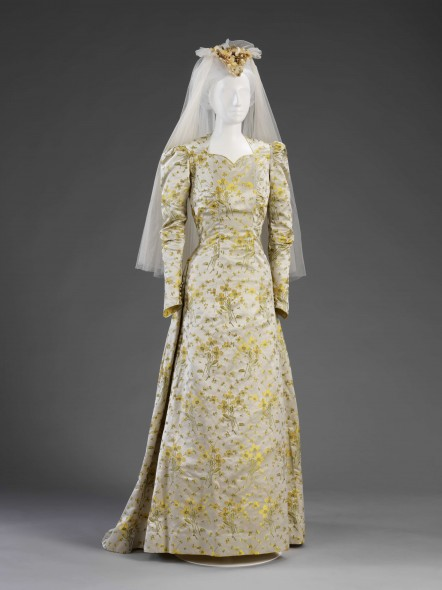 1946 Wedding dress from the exhibition Unveiled. This dress was made by Ella Dolling from a light weight upholstry fabric for Elizabeth King. Elizabeth did not have enough coupons to purchase dress fabric. Collection of Victoria and Albert Museum, Given by Mrs Gay Oliver Barrett.