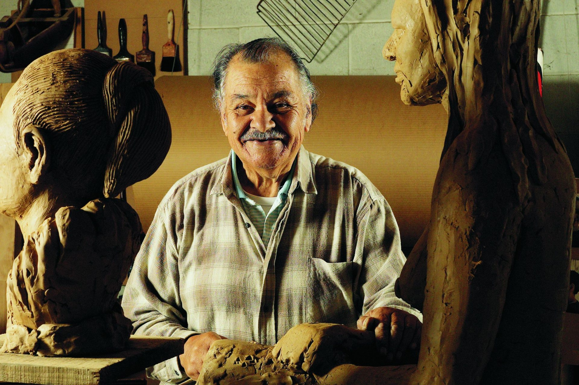 Arnold Wilson in his studio. Photo: Norman Heke, Te Papa
