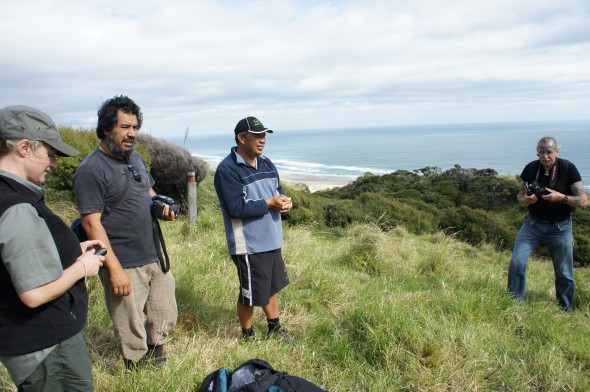 Nearly at the forest edge, overlooking the beautiful Mitimiti beach. From left to right: Fiona (DOC), Wayne, Anaru and Rongo (iwi). Photo Jessie Prebble © Te Papa