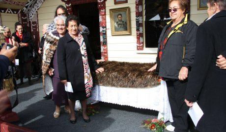 Descendants of Rāwinia Ngāwaka Tūkeke gather around the kahu kiwi before the blessing inside the wharenui Te Poho o Kahungunu. Rongomaraeroa marae, Porangahau. 6 May 2012.