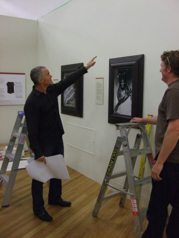 Wol Jobson, graphic designer, supervises install of some of the exhibition graphics. Photograph by Pamela Lovis, copryight Te Papa 2012.