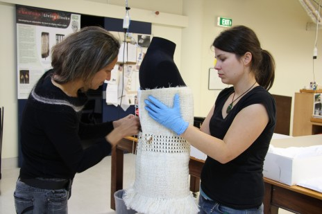 Kohai Grace and Object Support Mountmaker Penny Angrick fitting the dress to the mannequin.  Copyright Te Papa