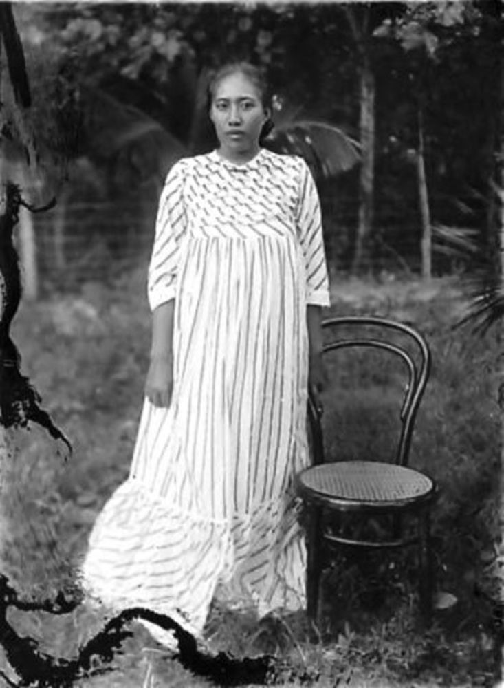 Photograph of a woman in a long dress with stripes