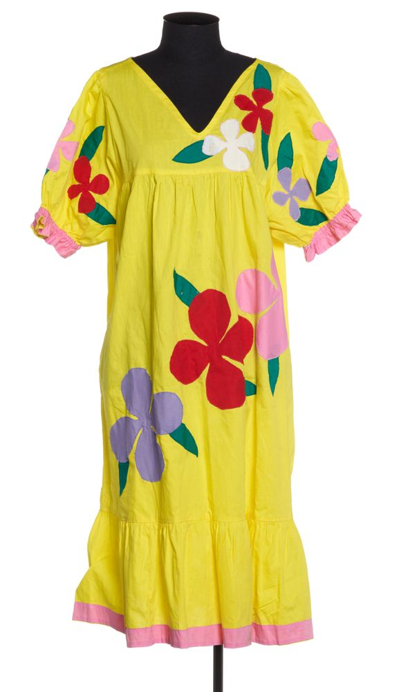 Bright yellow dress with stitched-on flowers