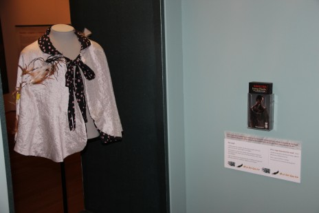 Apolline's beautiful kākahu and label on display in the Weavers' Studio of the Kahu Ora exhibition. Courtesy of Tai Tamariki Kindergarten