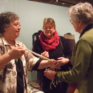 Joy Anderson showing muka strands to visitors