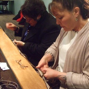 Veranoa Hetet (right) and Kahu Te Kanawa working on Veranoa's kakahu in the Weavers' Studio. Copyright Te Papa.